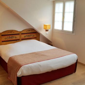 Chambre avec lit double dans l'appartement Frantz n°58